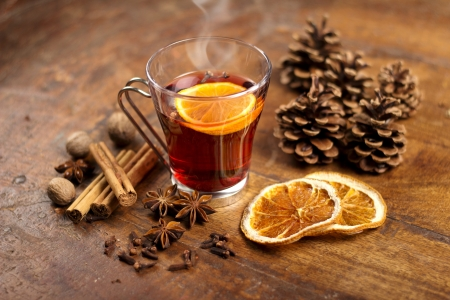 spiced: mulled wine with orange and spices on wooden background Stock Photo
