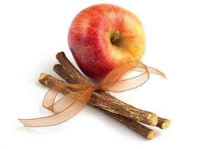apple and licorice  isolated on white background Stock Photo - 18989500