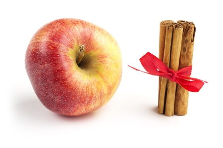 cinnamon sticks and apple isolatd on white background photo