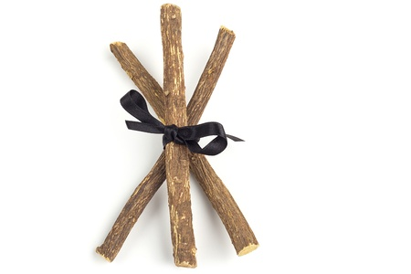 licorice: licorice roots tied with a black ribbon
