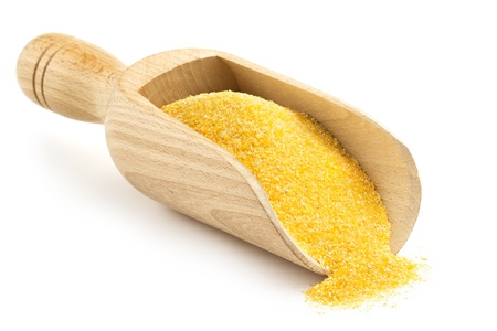 corn flour: wooden scoop with corn flour on white background