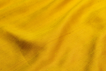 silken: drape of yellow elegant shantung with folds  Stock Photo