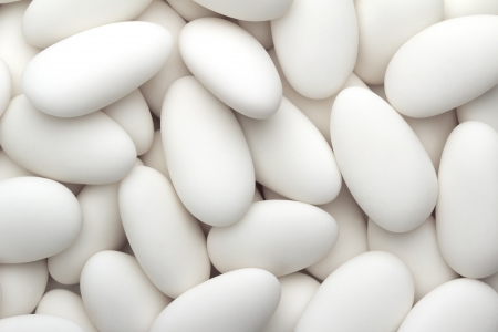 sugarplum: close up of a group of white sugared almonds