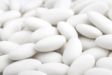 comfits: close up of  pile of white sugared almonds