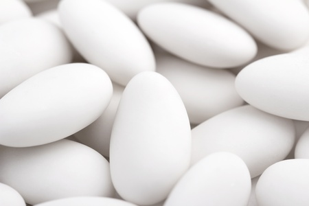 confetto: close up of a group of white sugared almonds