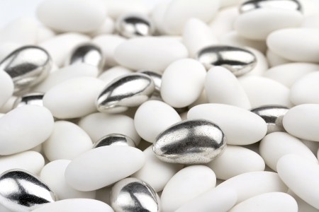 confetto: close up of white and silver sugared almonds
