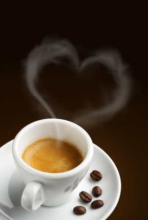 coffee cup with steam in shape of heart photo