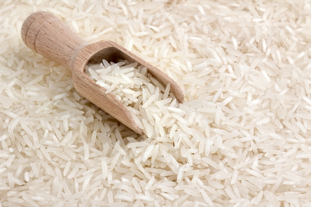 close up of basmati rice with wooden scoop