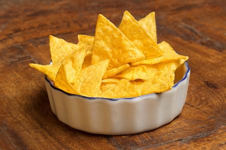 corn tortilla: bowl of tortilla chips on wooden background