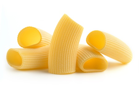 heap of italian pasta isolated on white background photo