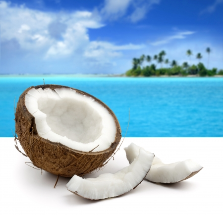 coconut on white background and beautiful seascape photo