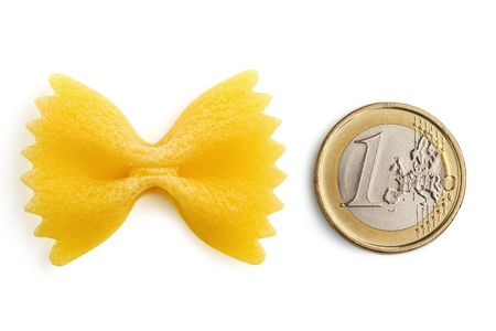 bow tie pasta and one euro coin on white background Stock Photo - 20083153