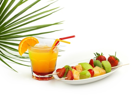 tequila sunrise cocktail and fruit skewers photo