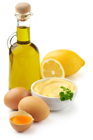 Mayonnaise: mayonnaise ingredients  olive oil, eggs and lemon Stock Photo