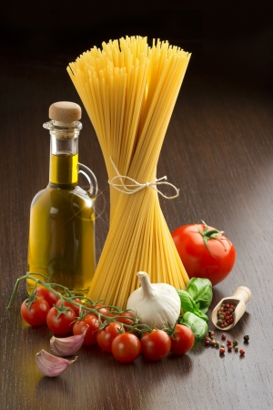 cooking ingredients: pasta, tomatoes, olive oil, garlic, basil and spices