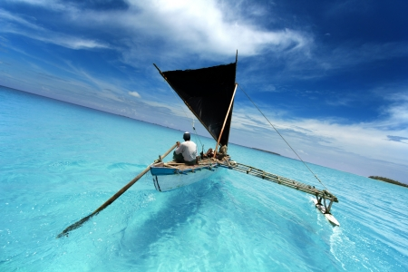 rowing boat sailing in a tropical lagoon Stock Photo