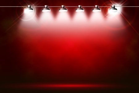 live event: red background illuminated by spotlights and sparkles