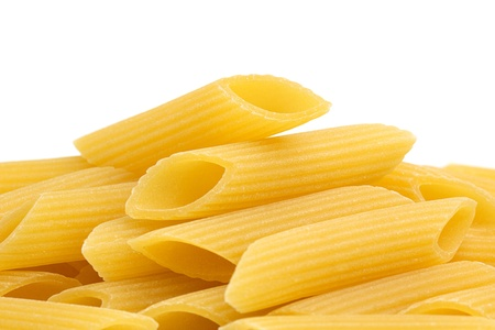 penne: close up of penne on white background