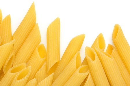 edge of italian pasta on white background photo