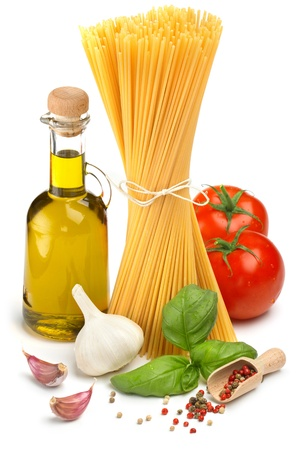 basil leaves: spaghetti, bottle of olive oil, tomatoes and herbs Stock Photo
