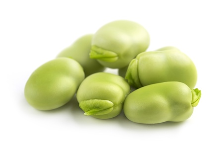 close up of fresh broad beans on white background
