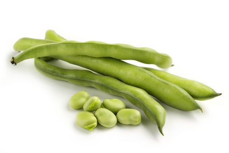 broad bean pods and seeds on white background photo