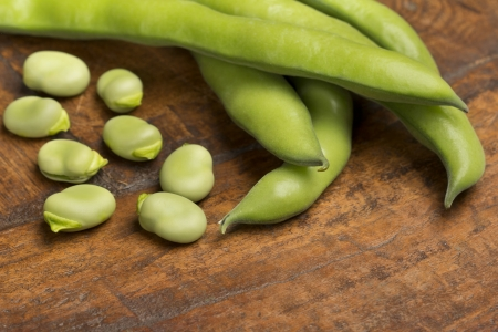 close up of broad beans on wooden background Stok Fotoğraf