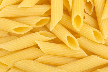 background of italian penne, traditional pasta photo