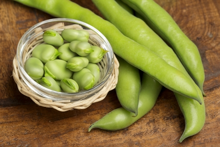 fresh broad beans in a glass bowl