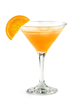 orange cocktail in a martini glass isolated on white background photo