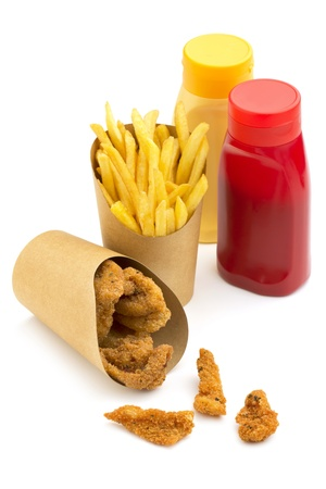 paper wrap of fries and chiken nugget and condiments photo