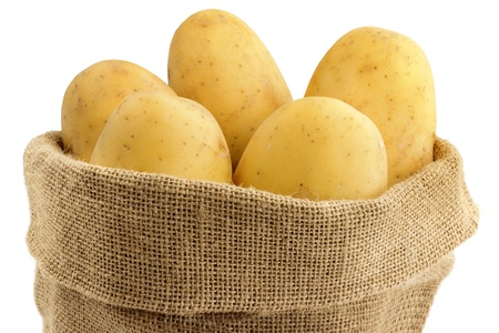 close up of raw potatoes in a jute bag  photo