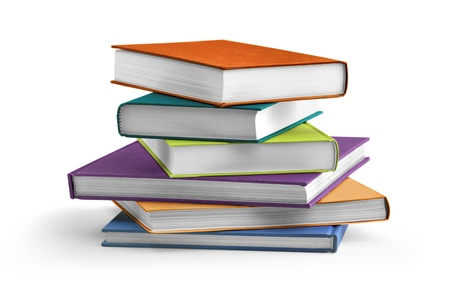 new books: stack of multi colored textbooks on white background