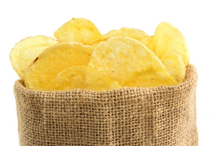 extreme close up of potato crisps in a jute bag photo
