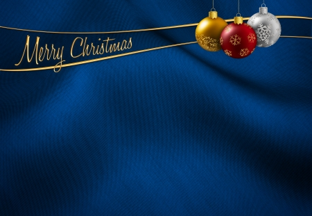 christmas baubles hanging on a blue silk background photo