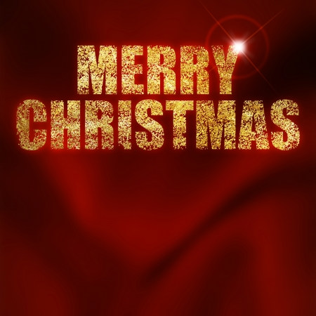 Christmas greeting written with gold powder on a red background Stock Photo - 23420432