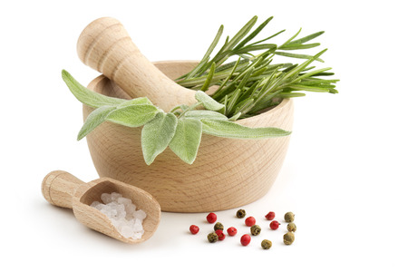 sage and rosemary in the mortar, scoop of coarse salt and peppercorns