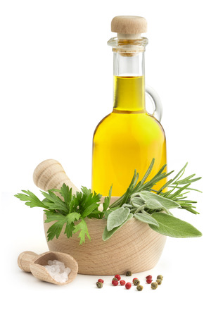 mortar and pestle with herbs, spices and olive oil photo