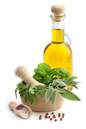 mortar and pestle with herbs, spices and olive oil Stock Photo
