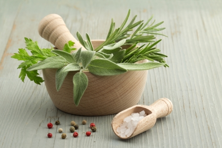 pesto: mortar and pestle with herbs and spices Stock Photo