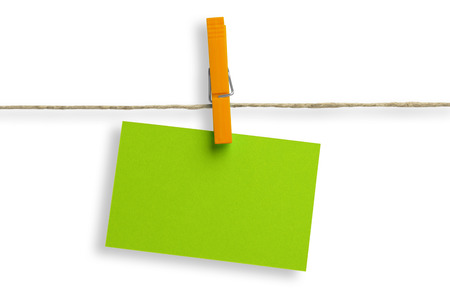 green cardboard stapled with an orange clothespin  photo