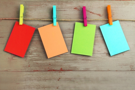 colorful cardboard hanging on a rope over a wooden background Stock Photo - 23437511