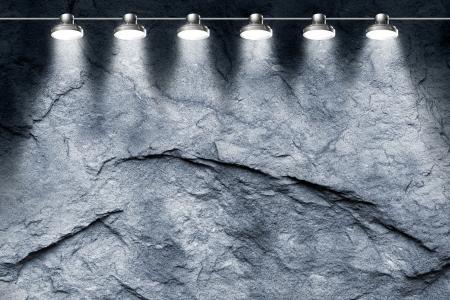 dark grey slate: spotlight illuminating a gray stone wall Stock Photo