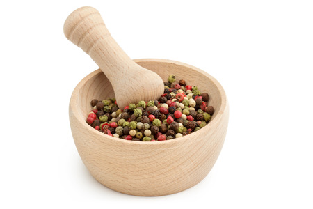mortar and pestle with peppercorn mix on white background photo