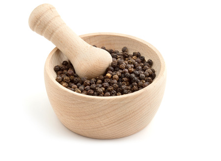 black peppercorns in mortar on white background photo