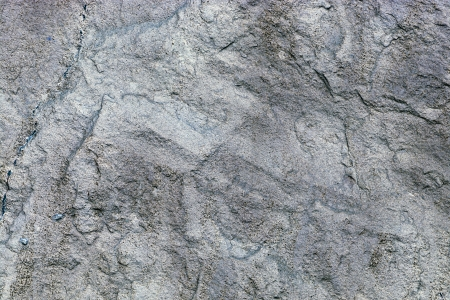 dark grey slate: close up of texture of a gray stone wall