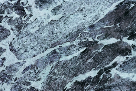 close up of a slab of mottled black marble photo