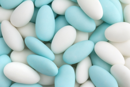 background of white and blue sugared almonds photo