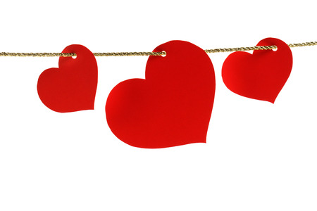 three heart-shaped cards hanging on a golden twine photo