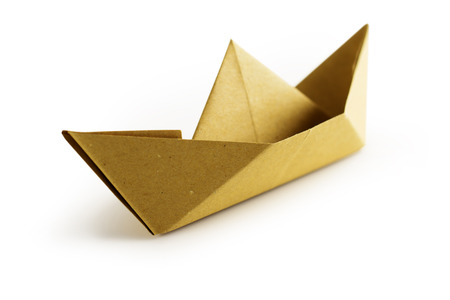 flotation: brown paper boat isolated on white background Stock Photo